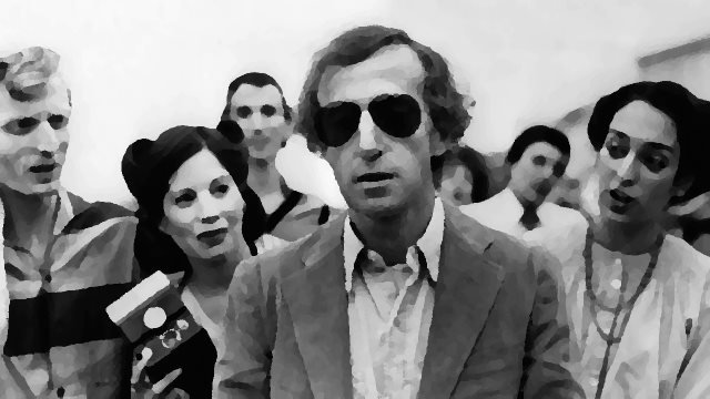 Woody Allen in STARDUST MEMORIES standing with glasses