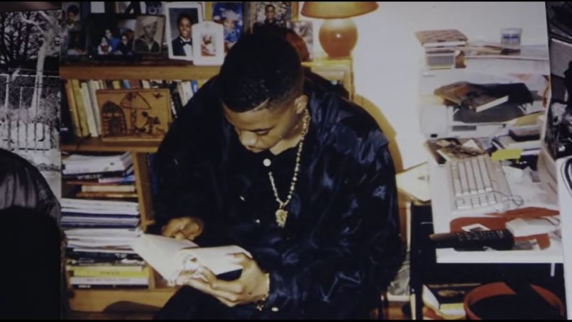 Early photo of Nas reading, from TIME IS ILLMATIC
