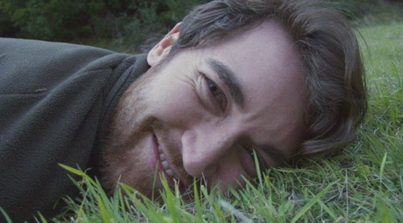 Ross Ulbricht lies in grass